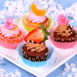 Stock Photo: Assorted cup cakes with angel, heart, tangerine, strawberry