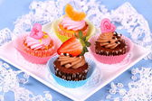 Assorted cup cakes with angel, heart, tangerine, strawberry — Stock Photo