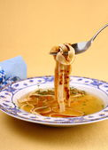 Pancake soup in blue plate, eating — Стоковое фото