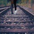 Two girls on train tracks together — Stock Photo
