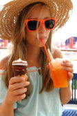 Beautiful girl in sunglasses, ice, slush on beach — Stock Photo