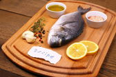 Bream fish on cutting board, ingredients, recipe label — Stock Photo