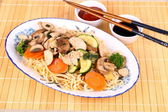 Chicken meat, china-asian noodle, vegetables — Stock Photo