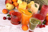 Juice with kiwi, apricot, cherry, watermelon, tangerine and pear — Stock Photo