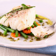 Cod Fillet with green beans, peas, parsley — Stock Photo