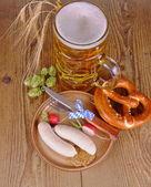 Oktoberfest menu - beer, white sausage, pretzel, radish, HDR — Stock Photo