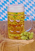 Bavarian beer, wheat, hop on wooden background — Stock Photo