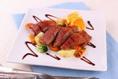 Roasted duck breast fillet, vegetables with orange — Stock Photo