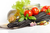 Italian Pasta with vegetables in wooden plate isolated on white. — Stock Photo