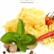 Italian Pasta with tomatoes, paprika and basil isolated on white. — Stock Photo