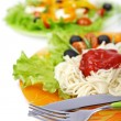 Pasta spaghetti with cherry tomato and salad — Stock Photo #14103421