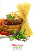 Italian Pasta with vegetables in wooden plate — Stock Photo