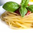 Spaghetti on the white plate with tomato sauce — Stock Photo #25982337