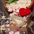 Oatmeal soap with roses — Stock Photo
