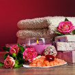 Spa Settings with roses and salt in bowl , towel. Candle,soap on — Stok fotoğraf