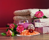 Spa Settings with roses and salt in bowl , towel. Candle,soap on — Stock Photo