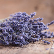 Bunch of lavender flowers on an old wood table — Stock Photo #35399251