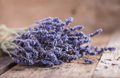 Bunch of lavender flowers on an old wood table — Stock Photo