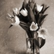 Bouquet of tulips in the vase. Style of old photos. Sepia — Stock Photo