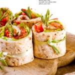 Salmon lavash rolls with fresh salad leafs — Stock Photo #36394587