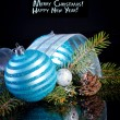 Christmas card with Christmas balls on a dark background — Stock Photo