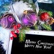 Tablet PC with Christmas decoration on black — Stock fotografie