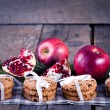 Pomegranate fruit, cookies and apples on wooden background — Stock Photo