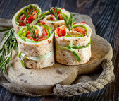 Salmon lavash rolls with fresh salad leafs — Stock Photo