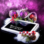 Tablet PC with Christmas decoration on black — ストック写真
