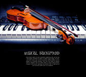 Violin and piano keys — Stockfoto