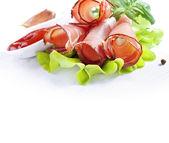 Sliced prosciutto — Stock Photo