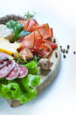 Prosciutto, cheese, salami and herbs — Stock Photo