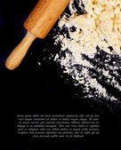 Dough and a rolling pin — Stock Photo