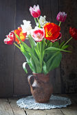 Tulip flowers in jar — Foto de Stock