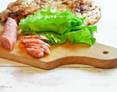 Salami with bread and salad — Stock Photo