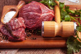 Raw meat with herbs — Stock Photo