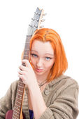 Beautiful yong woman  with red hair isolated on white with guitar — Stock Photo