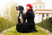 Woman walking with Great Dane outdoor — Stock Photo