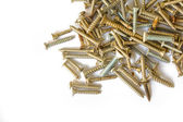 Pile of screws on white background — Foto Stock