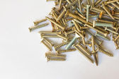 Pile of screws on white background — Stok fotoğraf