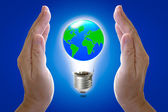 Abstract globe in light bulb and hand protection, protect our wo — 图库照片