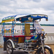 Stock Photo: Tricycle in Thailand with Mae Khong River.
