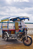 Tricycle in Thailand with Mae Khong River. — Stock Photo