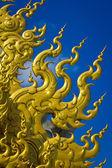 Golden sculpture at Wat Rong Khun, the temple at Chiangrai provi — Stock Photo