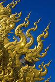 Golden sculpture at Wat Rong Khun, the temple at Chiangrai provi — Stock Photo