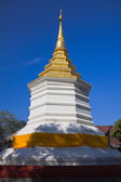 White pagoda and golden stupa on top. — Stock Photo