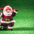 Santa Claus with silver ball on green background. — Stock Photo