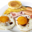 Fried eggs with bacon and toasts on white background — Stock Photo