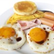 Fried eggs with bacon and toasts on white background — Stock Photo #36054143