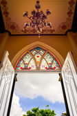 Open church door with hanging light — Stock Photo